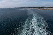 Wake in the sea from a Brittany Ferries roll-on / roll-off car and vehicle ferry at is leaves port on 26th September 2021 in Roscoff, Brittany, France. Brittany Ferries is the trading name of the French shipping company, BAI Bretagne Angleterre Irlande S.A. founded in 1973 by Alexis Gourvennec, that operates a fleet of ferries and cruise ferries between France and the United Kingdom.