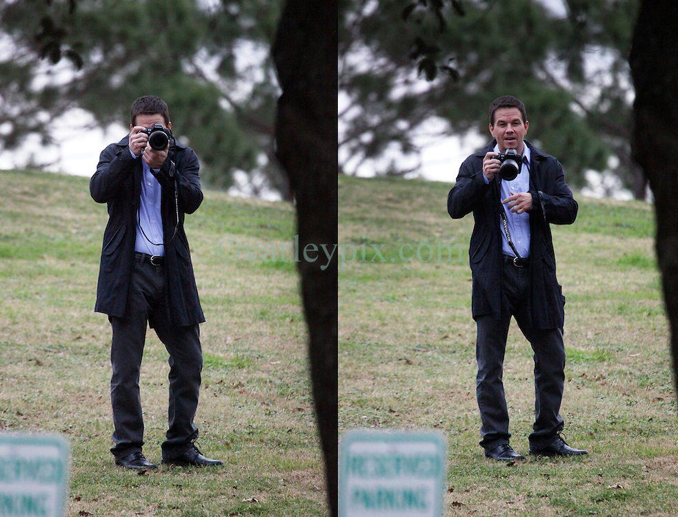 25 Jan 2012. Lafreniere Park, Jefferson Parish (just outside New Orleans), Louisiana USA. .Mark Wahlberg with a camera for a scene on the set of 'Broken City,' currently filming in New Orleans..Photo; Charlie Varley..