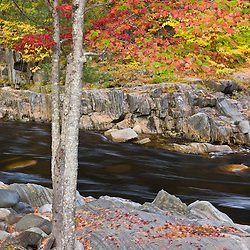 The falls in Coos Canyon in Byron, Maine. Fall.
