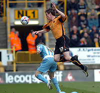 Photo: Kevin Poolman.<br />Wolverhampton Wanderers v Coventry City. Coca Cola Championship. 08/04/2006. Wolves player Maurice Ross goes over Coventry's Gary McSheffrey.