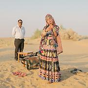 Sunset camel ride in the dunes. Visiting the Thar desert near Jaisalmer.