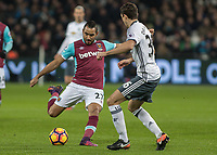 Football - 2016 / 2017 Premier League - West Ham United vs. Manchester United<br /> <br /> Dimitri Payet of West Ham has a shot at goal at The London Stadium.<br /> <br /> COLORSPORT/DANIEL BEARHAM
