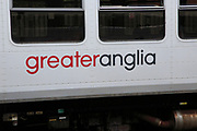 Greater Anglia company logo sign on train carriage, Norwich, Norfolk, England, UK