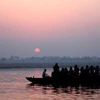Asia, india, Varanasi. Boat at Sunrise on the holy Ganges River at Varanasi.