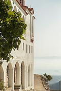 Monastery of Agios Menas on hilltop overlooking sea, Neohori, Chios, Greece
