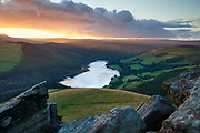 A final shaft of light above Ladybower Reservoir, captured from Whinstone Lee Tor - an elevated viewpoint at the southern end of Derwent Edge. A sunset landscape scene in the Derbyshire Peak District. England, UK.