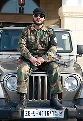 © licensed to London News Pictures. TRIPOLI, LIBYA  17/02/12. A soldier on the bonnet of an army Jeep in Martyrs' Square in Tripoli, Libya on the one year anniversary of the revolution. Please see special instructions for usage rates. Photo credit should read MICHAEL GRAAE/LNP