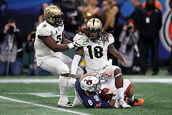 Auburn Tigers quarterback Jarrett Stidham (8) is tacked by UCF Knights linebacker Shaquem Griffin (18) during the 2018 Chick-fil-A Peach Bowl NCAA football game on Monday, January 1, 2018 in Atlanta. (Jason Parkhurst / Abell Images for the Chick-fil-A Peach Bowl)