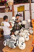 Artists work on skeleton decorations in preparation for the Day of the Dead Festival known in spanish as Día de Muertos on October 27, 2014 in Oaxaca, Mexico.