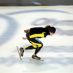 Calgary, Alberta  July 27 2005: Olympic-caliber speed skaters practice on the Olympic oval at the University of Calgary Wednesday for the upcoming speedskating season. The oval was built for the 1988 Calgary Olympics and is a popular training venue for world-class athletes. <br /> ©Bob Daemmrich