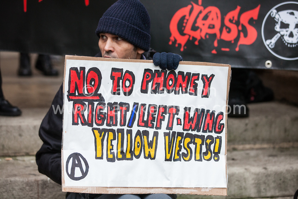 London, UK. 12th January, 2019. Supporters of Class War protest against the 'Britain is Broken: General Election Now' demonstration organised by the People's Assembly Against Austerity on the basis that neither the left-wing or right-wing yellow vests in the UK are equivalent to the 'gilets jaunes' in France and that a revolution and not a general election is required in order to solve the problems of the working class in the UK.