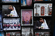 Harry and Meghan postcards next to a postcard of London landmarks for sale on a rack on 2nd July 2021 in London, United Kingdom.