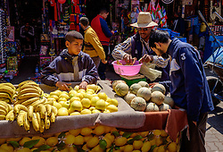 People shopping at a fruit stall in the medina, Marrakech, Morocco, North Africa<br /> <br /> (c) Andrew Wilson | Edinburgh Elite media