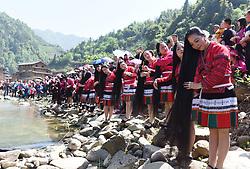 April 18, 2018  - Longsheng, China - Yao ethnic women comb their long hair along the riverside at a celebration of ''Sanyuesan'' festival in Longsheng County, south China's Guangxi Zhuang Autonomous Region. People of China's Yao ethnic group in Longsheng have a tradition to celebrate the Sanyuesan Festival on the third day of the third lunar month. (Credit Image: © Wei Jiyang/Xinhua via ZUMA Wire)