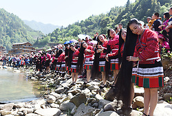 April 18, 2018  - Longsheng, China - Yao ethnic women comb their long hair along the riverside at a celebration of ''Sanyuesan'' festival in Longsheng County, south China's Guangxi Zhuang Autonomous Region. People of China's Yao ethnic group in Longsheng have a tradition to celebrate the Sanyuesan Festival on the third day of the third lunar month. (Credit Image: © Wei Jiyang/Xinhua via ZUMA Wire)