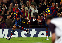 FC Barcelona's forward Thierry Henry (L) celebrates after scoring a goal against Glasgow Rangers with his teammates Abidal and Ronaldinho (R) during their Champions League footbal match against Glasgow Rangers at Camp Nou stadium in Barcelona, 07 November 2007. INSIDEFOTO / CPA / PACO SERINELLI
