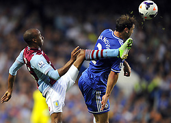 "Aston Villa's Fabian Delph catches Chelsea's Branislav Ivanovic with a high boot  - Photo mandatory by-line: Joe Meredith/JMP - Tel: Mobile: 07966 386802 21/08/2013 - SPORT - FOOTBALL - Stamford Bridge - London - Chelsea V Aston Villa - Barclays Premier League - EDITORIAL USE ONLY. No use with unauthorised audio, video, data, fixture lists, club/league logos or ""live"" services. Online in-match use limited to 45 images, no video emulation. No use in betting, games or single club/league/player publications"