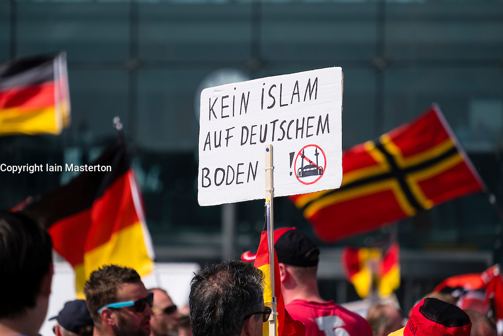 """Far-right demonstrators protest against Islam, refugees and Angela Merkel in Berlin. Sign says """" No Islam on German soil""""."""