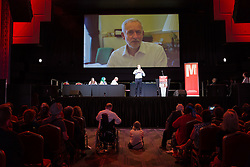 © Licensed to London News Pictures. 07/07/2016. LONDON, UK.  Supporters listen to a video message from Jeremy Corbyn at a Momentum rally in support of keeping Jeremy Corbyn as the Labour party leader at the Troxy in east London on 6th July 2016. The event was organised by Momentum, a group of Labour Party supporters who are campaigning for Jeremy Corbyn to remain as leader of the Labour Party, following the recent resignation of many shadow cabinet MP's and the growing likelihood of a Labour Party leadership challenge..  Photo credit: Vickie Flores/LNP