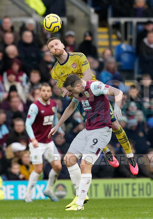 Shkodran Mustafi of Arsenal out jumps Chris Wood of Burnley during the Premier League match at Turf Moor, Burnley. Picture date: 2nd February 2020. Picture credit should read: Andrew Yates/Sportimage