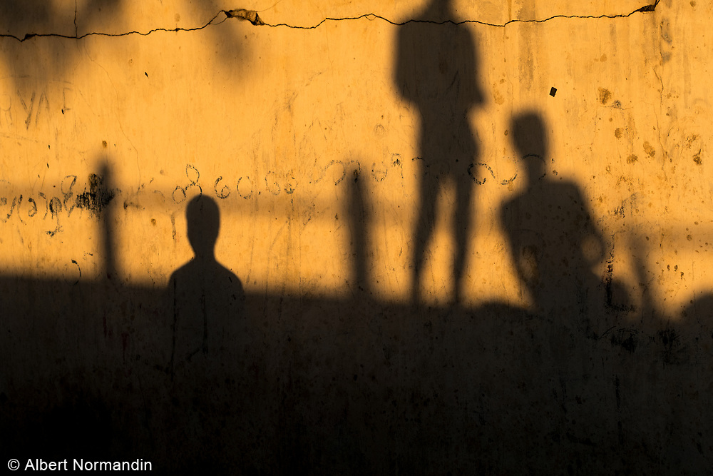 Boys playing football in the streets at sunset, Monywa, Myanmar