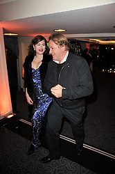 JULIAN OZANNE and JASMINE GUINNESS at Quintessentially's 10th birthday party held at The Savoy Hotel, London on 13th December 2010.