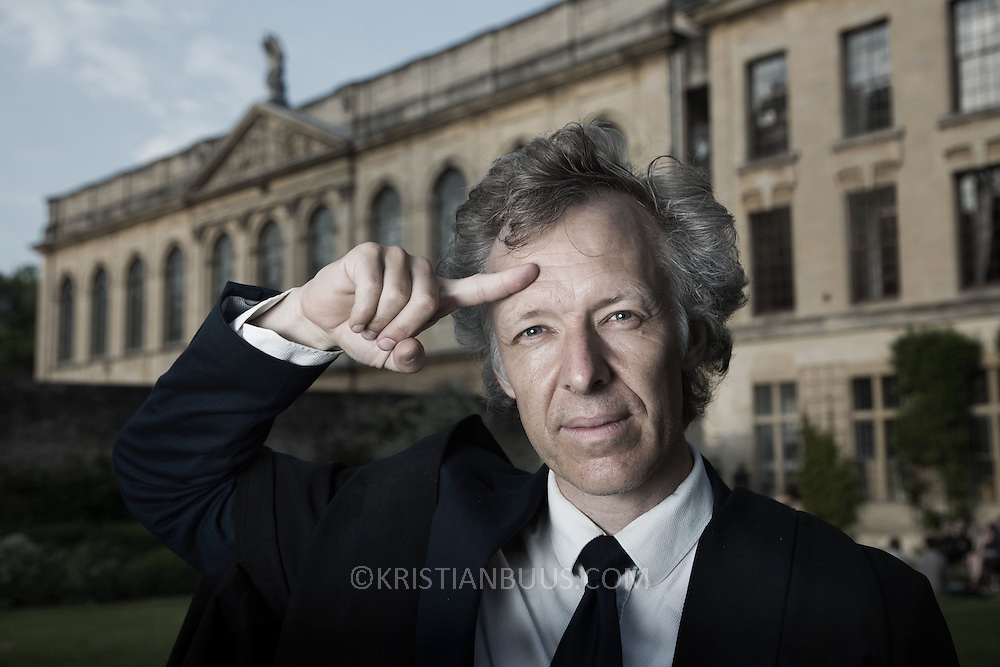 Professor Kringelbach points to the pleasure centre which is at the front of the brain just beneath the skull.  Proffessor Morten Kringelbach is  Associate Professor and Senior Research Fellow at Queen's College, Oxford and researches into the patterns of the pleasure centre of the brain.<br /> Photographed at Queen's College, Oxford.
