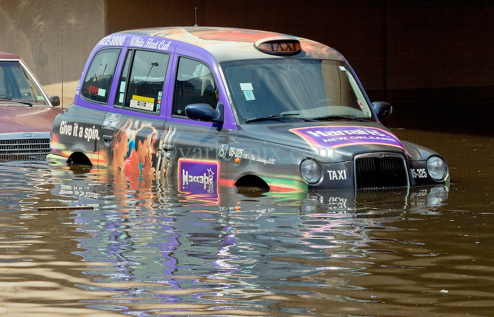 30 August, 2005. New Orleans Louisiana. Hurricane Katrina aftermath. <br /> A London taxi parked in floodwaters outside the Superdome.<br /> Photo Credit: Charlie Varley/varleypix.com