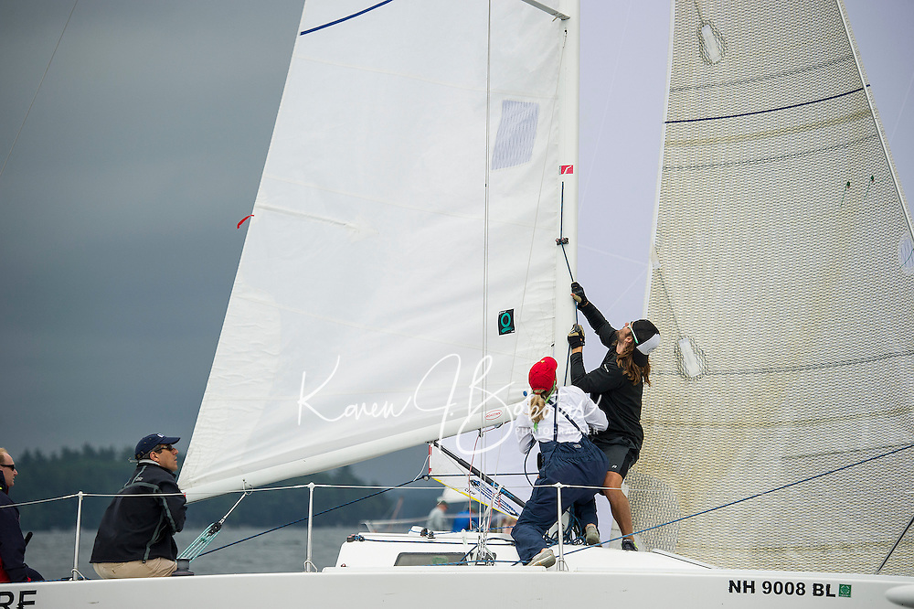 """Warner Nickerson (far right) and the """"Pressure"""" crew working the sail rigging during JBT Race for the Cure held Saturday from Winnipesaukee Yacht Club.  (Karen Bobotas/for the Laconia Daily Sun)"""