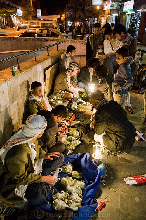 Qat sellers wait for customers after dark on a street in Sanaa, Yemen. Qat chewing is a popular pastime in Yemen.