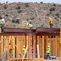 081314       Cable Hoover<br /> <br /> Construction workers build the lower levels of new hotel on east Historic Highway 66 in Gallup Wednesday.