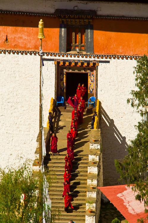 Procession leaving the Paro Dzong to the Paro Tsechu (festival), Paro, Bhutan