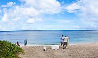 Guam Manahak, juvenille rabbitfish, with fishermen May 3, 2013.