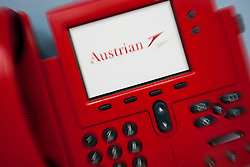 THEMENBILD - ein rotes Telefon der Austrian Airlines am Flughafen Innsbruck, Österreich, aufgenommen am 09.07.2015 // a red phone of Austrian Airlines at Innsbruck Airport, Austria on 2015/07/09. EXPA Pictures © 2015, PhotoCredit: EXPA/ Jakob Gruber