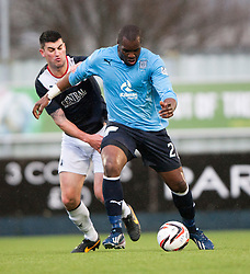 Falkirk's Jonathan Flynn and Dundee's Christian Nade.<br /> Falkirk 2 v 0 Dundee, Scottish Championship game at The Falkirk Stadium.<br /> © Michael Schofield.