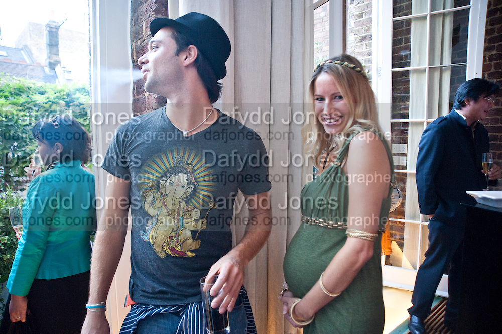 SACHA JAFRI; LUCY JAFRI, The launch party for Elephant Parade hosted at the house of  Jan Mol. Covent Garden. London. 23 June 2009.
