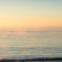 Sea smoke rising from the ocean coloured by early morning sunlight gives a Rothko like feel to the day.