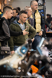 Spectator's checking out the LowRide Magazine custom bike show during Motor Bike Expo. Verona, Italy. January 24, 2016.  Photography ©2016 Michael Lichter.