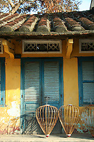 Interspersed with the Chinese and Vietnamese architectural gems are wooden and stucco houses that show both influences from east and west. Adding color to this already eclectic mixture are numerous examples of Hoi An's French Colonial past. These simple but elegant buildings (most of them well preserved or renovated) have given the Hoi An its UNESCO World Heritage Status.
