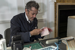 October 5, 2018 - London, UK - LONDON, UK. Tom Sachs issues a passport. Preview of ''Swiss Passport Office'' by American artist Tom Sachs at Galerie Thaddaeus Ropac in Mayfair.  To coincide with Frieze Week, the gallery will remain open for 24 hours from 6pm 5 October to 6pm 7 October for the issuing of serial-numbered Tom Sachs Swiss passports for visitors.  The installation reflects the concerns relating to Brexit, Syria and Donald Trump's immigration policies and challenges the notion of global citizenship. (Credit Image: © Stephen Chung/London News Pictures via ZUMA Wire)