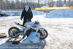 Russian custom bike builder Yaroslav Tatarinov prepping his 2008 Kawasaki 1350 GTR 1350cc with incredible hand crafted aluminum body work after it arrived for the Baikal Mile Ice Speed Festival. Maksimiha, Siberia, Russia. Tuesday, February 25, 2020. Photography ©2020 Michael Lichter.