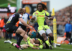 Sale Sharks Marland Yarde is tackled by Exeter Chiefs Lachie Turner during the Aviva Premiership match at Sandy Park, Exeter.