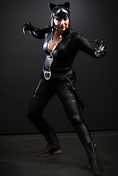 © Licensed to London News Pictures . 26/07/2015 . Manchester , UK . Portrait : CAT WOMAN ( Stephanie Stone , 29 , from Stoke-on-Trent ) at the venue . Comic Con convention at Manchester Central Convention Centre . Photo credit : Joel Goodman/LNP