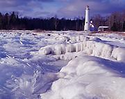 Ice formations on Sturgeon Point with Sturgeon Point Lighthouse beyond, Sturgeon Point State Park, Lake Huron, Michigan.