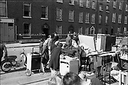 """15/06/1963.06/15/1963.15 June 1963.Dublin tenements evacuated at Fenian Street..The scene this morning at Fenian Street, Dublin as families living in century  old tenement houses evacuate their homes at No.9 and 10, and await the expected collapse of the buildings. """"The houses are only a few doors away from those which collapsed on Wednesday last, killing two schoolgirls. Most of the families spent the night on the roadside with their furniture..Dublin Tenements, collapsing in various parts of the city recently has caused a stste of emergency. Corporation officals are franticly trying to find alternative accomodation for hundreds of families occuping condemned or dangerous houses."""""""
