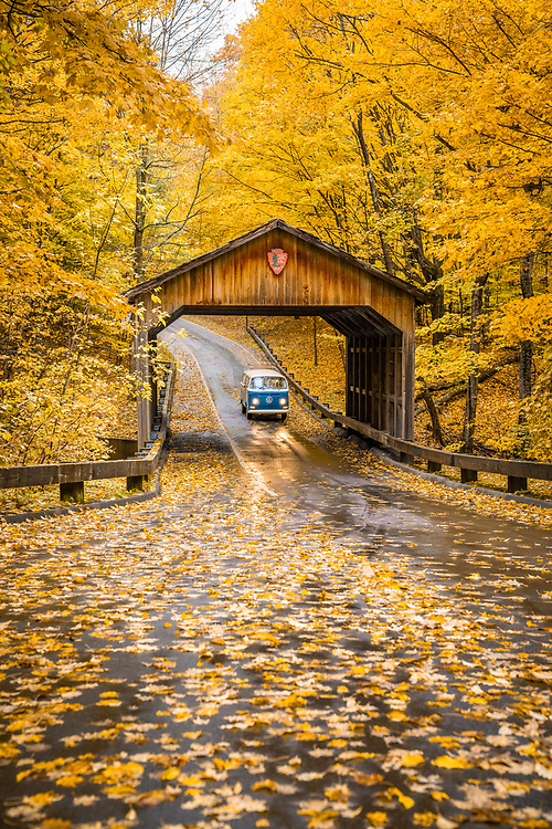 Exploring Pierce Stocking Drive at Sleeping Bear Dunes National Lakeshore during a fall color road trip in a vintage Volkswagen van along the Lake Michigan coast near Traverse City, Michigan.