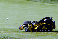 16 July 2006:  A golf bag rests horizontally next to the green waiting on a caddy to pick it back up.<br /> <br /> The John Deere Classic is played at TPC at Deere Run in Silvis Illinois, just outside of the Quad Cities