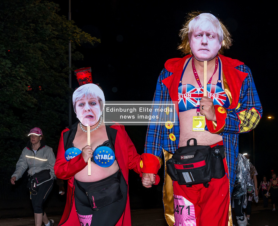 Pictured: Moonwalk Scotland, Edinburgh, Scotland, United Kingdom, 08 June 2019. The 14th Moonwalk Scotland 'Walk the Walk' night-time event with several thousand participants wearing specially decorated bras with a circus theme to raise money and awareness for breast cancer causes. Moonwalkers Irene & Graham Mcintosh. Irene is walking her 9th full marathon & Graham is walking his 7th full marathon.<br /> en route.<br /> <br /> Sally Anderson | EdinburghElitemedia.co.uk