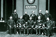 Social Democratic members of the Reichstag posing in the foyer of the Reichstag building, 1889. Standing left to right: Dietz, Kuhn, Liebknecht, Grillenberger, and Singer.  Sitting left to right: Schumacher, Harm, Bebel, Meister, and Frohme.