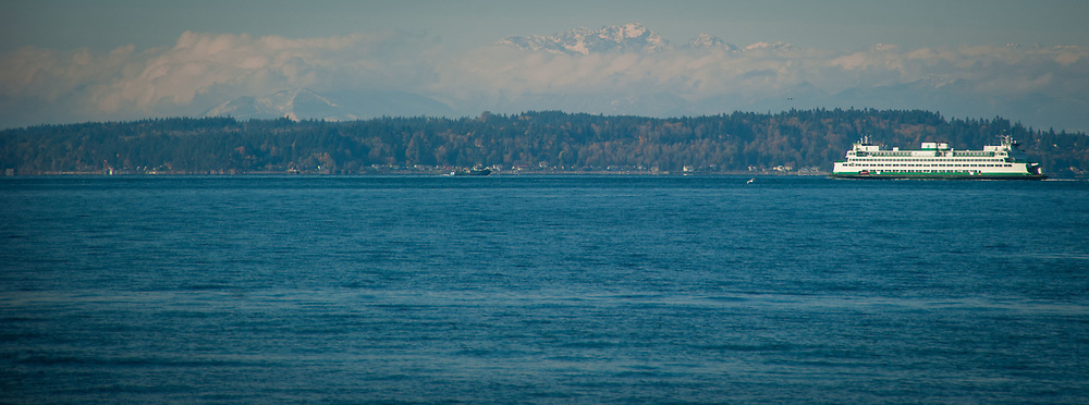 2017 NOVEMBER 06 - Washington State Ferry in Puget Sound with Olympic Mountains in background, Seattle, WA, USA. By Richard Walker